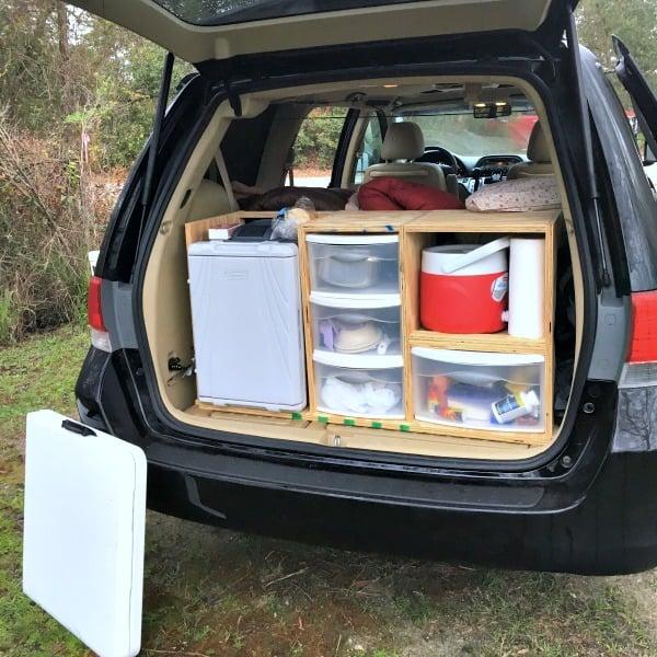 Minivan camper kitchen area.