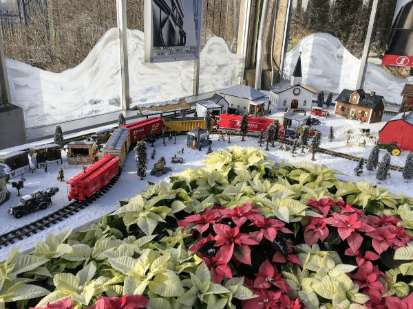The Christmas village and train on display at the Garfield Conservatory in Indianapolis at Christmas time.