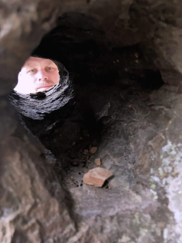 Peekaboo! I see you...through a rock on a trail inside Natural Bridge State Resort Park