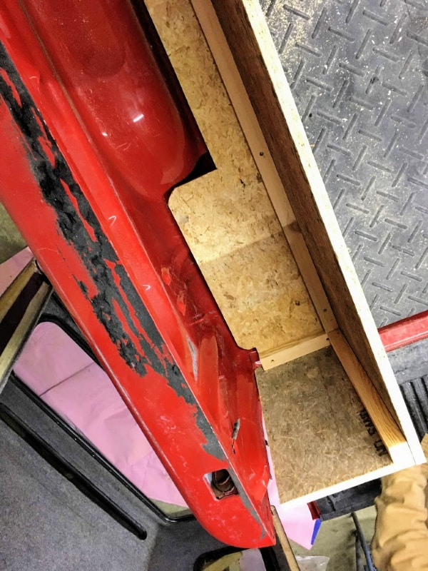 A picture of how the truck camper kitchen and storage is built.