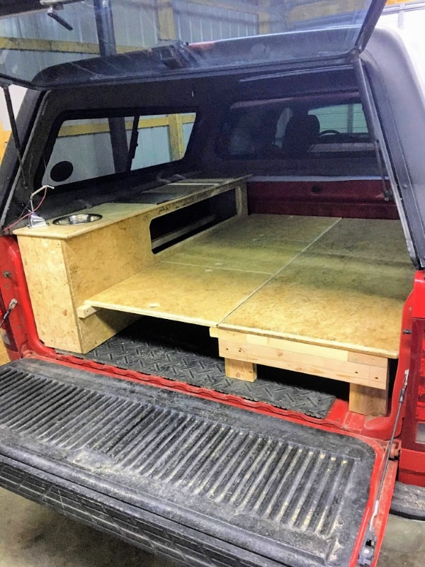 What the DIY truck bed camper will look like in bed mode for two people.