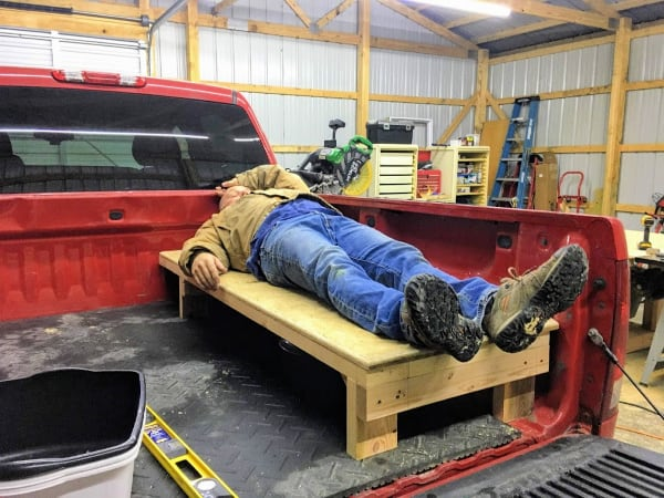 Jack trying out the bed platform in the truck shell camper.