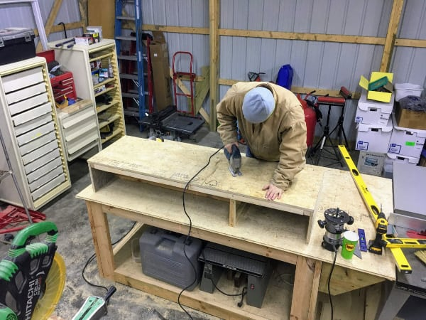 Jigsawing out the storage access area for the truck bed camper.