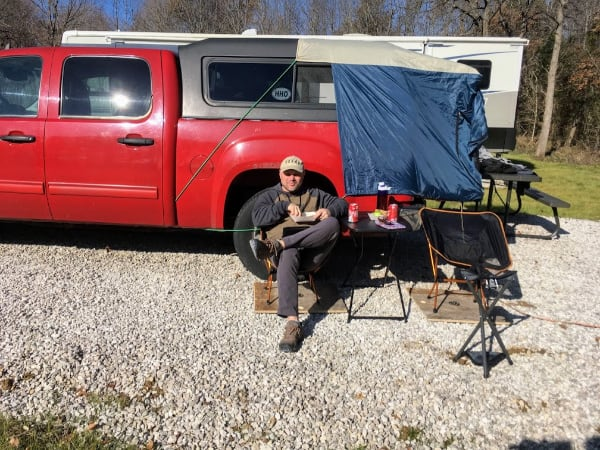 Relaxing while DIY pick up truck camping.