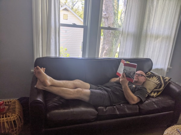 Husband Relaxing in our Airbnb in Michigan City, Indiana.