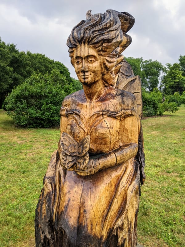 Leila carving in the Fantasy Forest, Battle Creek, Michigan.