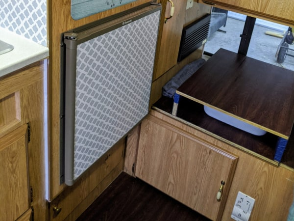 How To Make The Best Use Of Space In A Truck Camper: add a storage step up to the bed area.