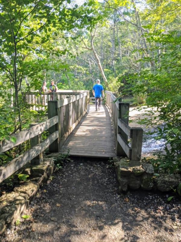 Make sure to walk over the bridge at the top of Crabtree Falls in Virginia. Located a few miles off the Blue Ridge Parkway.