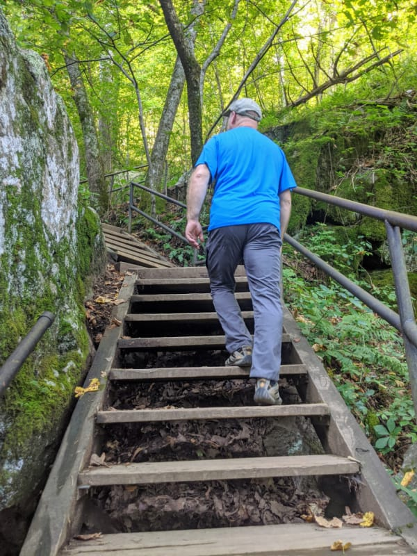 There are numerous stairs to climb on the trail to the top of Crabtree Falls, Virginia. Located a few miles off the Blue Ridge Parkway.